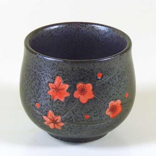 Teecup rote Blüten